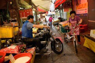 Motorcyle and bike in Oncheonjang market in Busan, Korea.