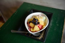 Patbingsu with yogurt and fruit on a table in a cafe in Gamcheon Cultural Art Village