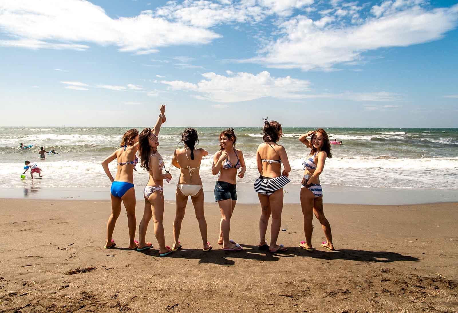 Japanese women in bikinis at Yuigahama Beach in Shonan, Japan, home of the 2020 Summer Japan Olympic sailing events