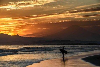 A surfer at Shonan beach near Mt. Fuji, Japan, home of the 2020 Summer Japan Olympic sailing events