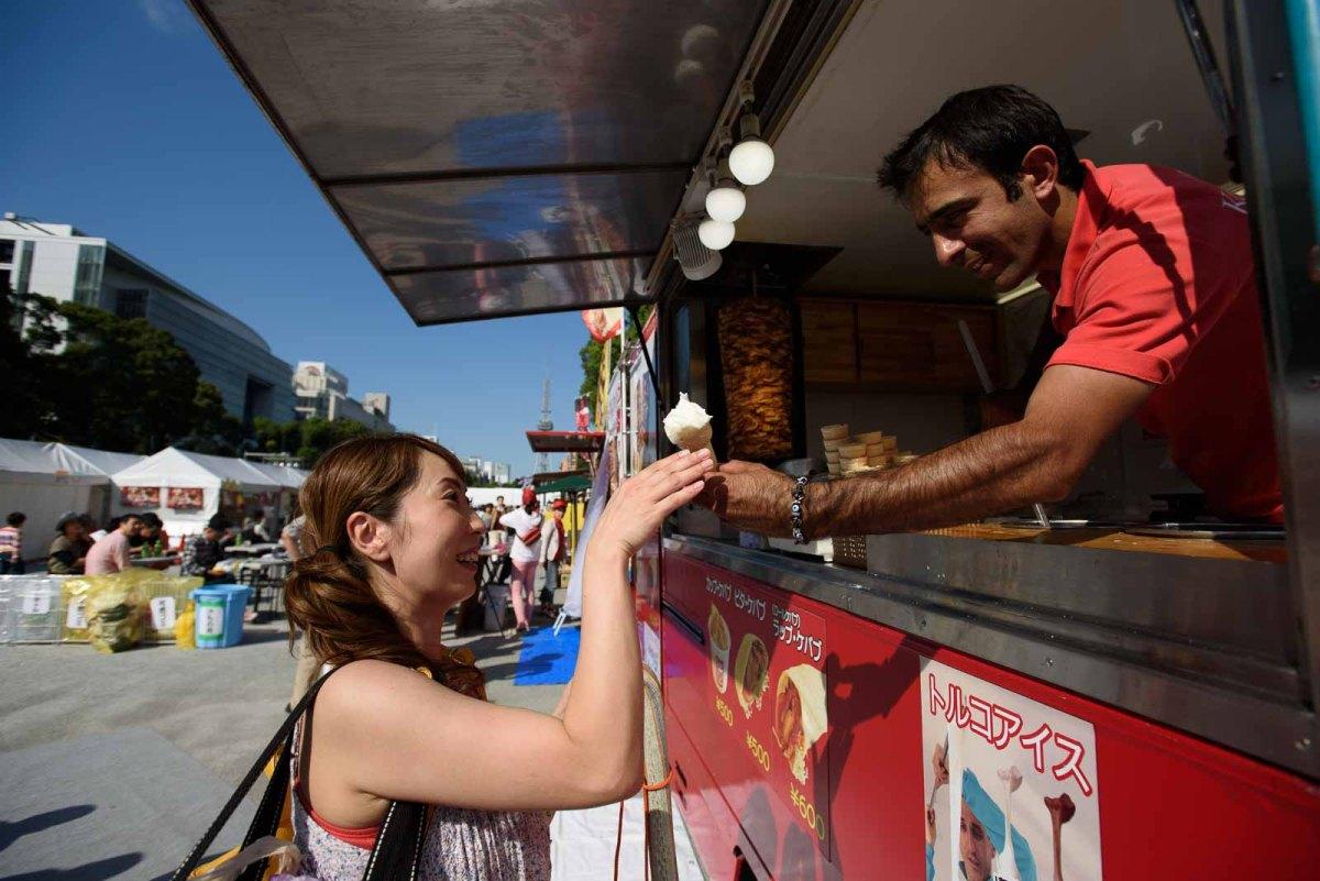 A man serves ice cream at the Nagoya Festival.