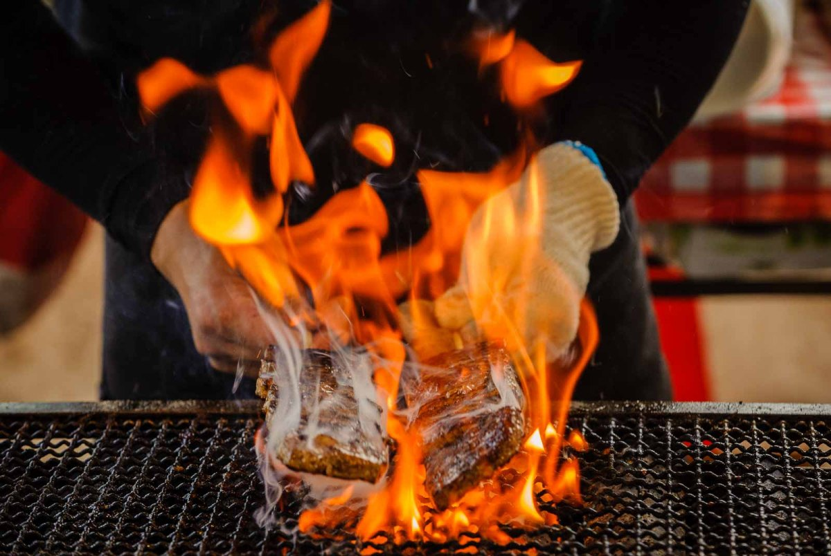 Kushiyaki is engulfed in flames on a grill at the Nagoya Festival. Nagoya photographer Ben Weller.