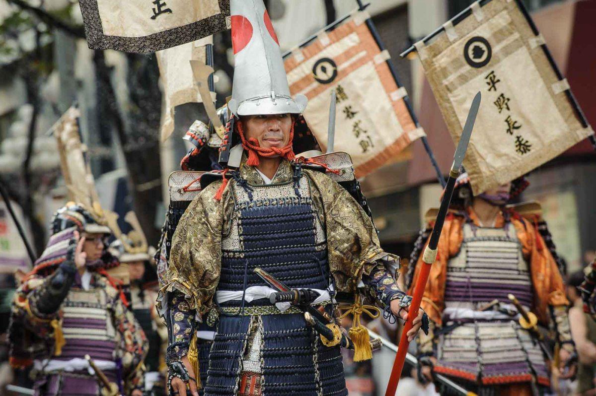Men dressed in samurai clothes.