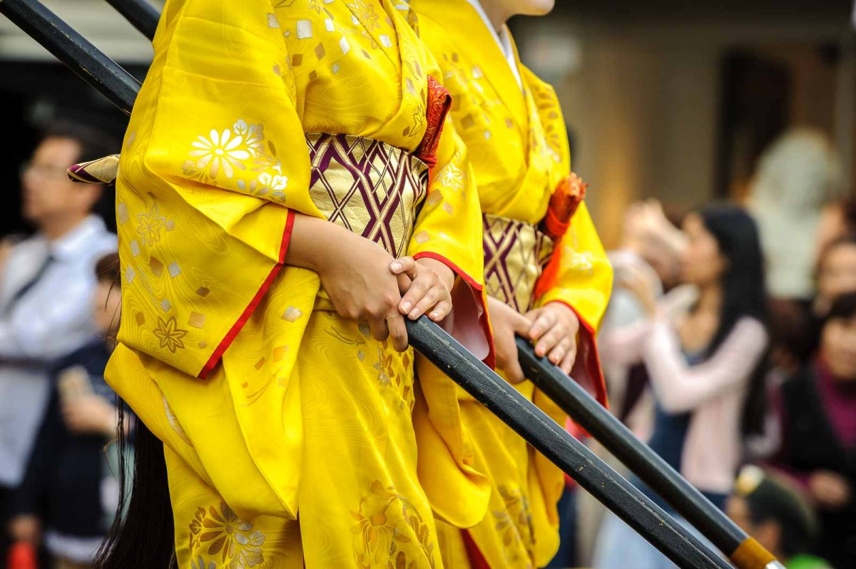 Geisha performers walk during the parade.