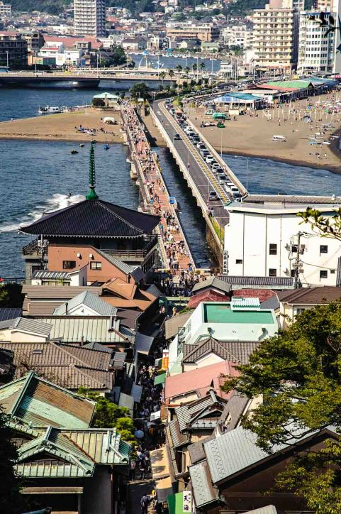 Enoshima Island offers tourists an idyllic walk among parks, shrines, temples, caves, tidal pools, and rock formations. Get your reservations early for a ryokan (traditional Japanese inn) where you can sleep on tatami mats and bathe in hot springs.