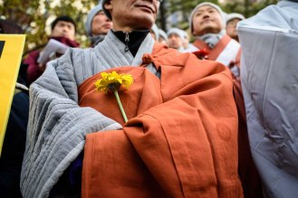 Buddhist monks attend an interfaith demonstration and vigil prior to protests in Seoul.